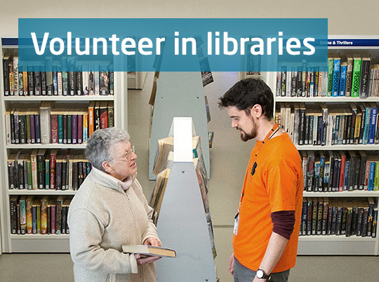 Volunteer helping customer in library