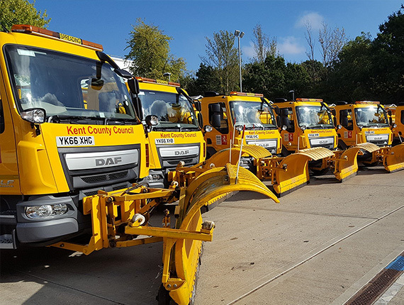 Row of parked gritting lorries