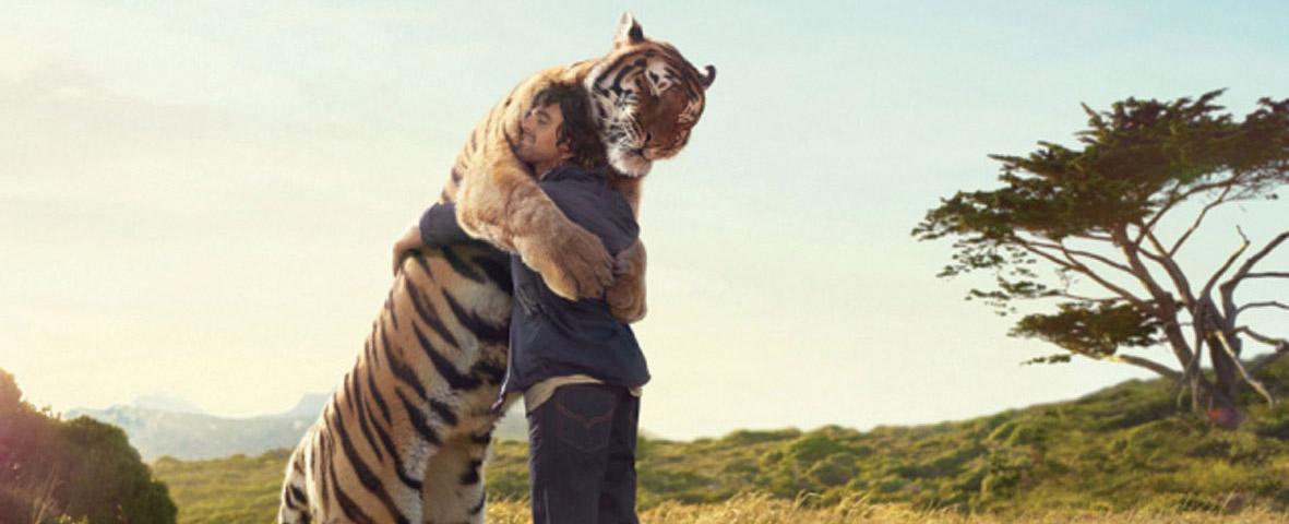 Man embracing tiger
